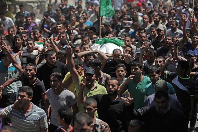 mourners-chant-angry-slogans-during-the-funeral-of-widad-mustafa-deif-27-who-was-killed-along-with-her-8-month-old-son-ali-mohammed-deif-in-israeli-strikes-in-gaza-city-late-tuesday-during-their-funeral-in-jabaliya-refugee-camp-in-the-northern-gaza-strip-on-wednesday-aug-20-2014-widad-was-the-wife-of-mohammed-deif-the-leader-of-the-hamas-military-wing