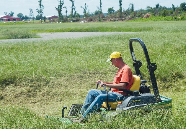 tim-grantham-working-under-the-national-emergency-grant-program-mows-the-softball-and-baseball-fields-at-vilonia-as-work-begins-to-try-and-bring-the-fields-back-from-the-tornado-that-destroyed-them-earlier-this-year