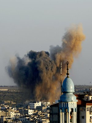 Smoke, dust and debris rise Wednesday after an Israeli strike hit Gaza City in the northern Gaza Strip.