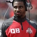 In this April 12, 2014, file photo, Ohio State quarterback Braxton Miller watches from the sidelines...