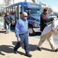 FILE PHOTO DAVID GOTTSCHALK Riders exit an Ozark Regional Transit bus in Fayetteville.