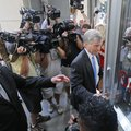 Former Virginia Gov. Bob McDonnell, right, arrives at federal court with his attorney, Henry Asbill,...