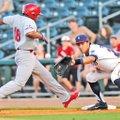 Staff Photo J.T. Wampler Mark Threlkeld, Northwest Arkansas first baseman, reaches for the pick-off...