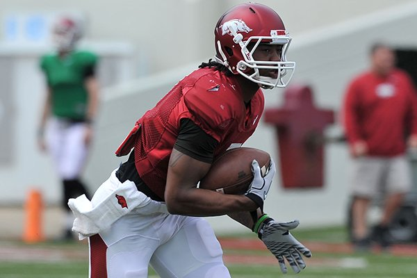 Arkansas receiver Damon Mitchell returns a punt during practice on Saturday, April 12, 2014 at Razorback Stadium in Fayetteville.