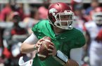 Arkansas quarterback Austin Allen looks for a receiver during the Red-White Game on Saturday, April 26, 2014 at Razorback Stadium in Fayetteville.