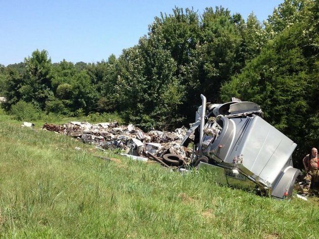 an-18-wheeler-crashes-and-spills-its-load-off-an-eastbound-interstate-40-exit-ramp-thursday-aug-21-2014