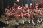 Deatrich Wise Jr., from left, Brooks Ellis and Daunte Carr, all with the University of Arkansas football team, laugh Friday, Aug. 22, 2014 while the teammates introduce each other at the 2014 Arkansas Football Kickoff Luncheon at the Northwest Arkansas Convention Center in Springdale.