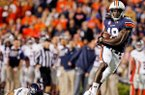 Auburn wide receiver Sammie Coates, right, catches a pass over Florida Atlantic defensive back Cre'von LeBlanc for a touchdown. (Butch Dill/AP)