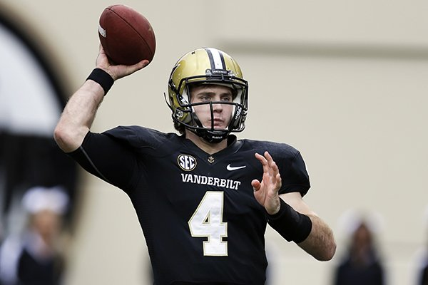In this Oct. 19, 2013, file photo, Vanderbilt quarterback Patton Robinette passes against Georgia in an NCAA college football game in Nashville, Tenn. (AP Photo/Mark Humphrey, File)
