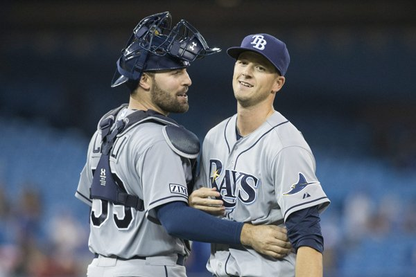 Tampa Bay Rays pitcher Drew Smyly, right, celebrates with catcher Curt Casali after a complete game two hit shut out 8-0 win over Toronto Blue Jays in a baseball game, Friday, Aug. 22, 2014 in Toronto. (AP Photo/The Canadian Press, Chris Young)