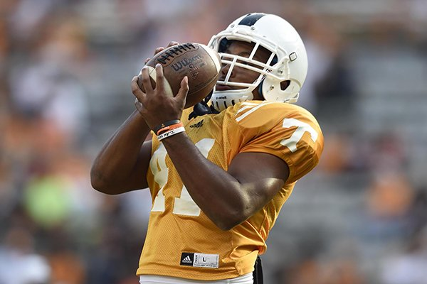 In this Aug. 6, 2014 file photo, Tennessee defensive back Elliott Berry makes a catch during NCAA college football practice in Knoxville, Tenn. Twins Elliott and Evan Berry say they don't feel any pressure trying to follow their older and very successful brother, Eric Berry, who starred for Tennessee from 2007-09 before getting selected in the first round of the NFL draft. (AP Photo/Knoxville News Sentinel, Adam Lau, File)