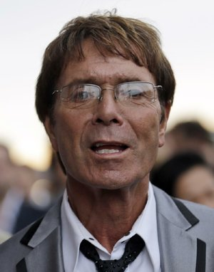 "FILE - In this Friday, July 27, 2012 file photo, British singer Cliff Richard arrives for the opening ceremony at the 2012 Summer Olympics, in London. British police say they are searching a house belonging to singer Cliff Richard in connection with sexual allegations dating back to the 1980s. South Yorkshire Police say eight officers are at the house in Berkshire, west of London on Thursday, Aug. 14, 2014.  The force said the allegations ""involve a boy who was under the age of 16 at the time."" (AP Photo/Markus Schreiber, File)"