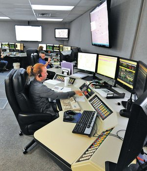 STAFF PHOTO J.T. Wampler Heather Bowlin, a dispatcher at Springdale Police Department's dispatch center, works Friday.