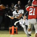 Lincoln receiver Alec Pitts pulls in a touchdown pass past Farmington defender Cody Larrow in the fi...