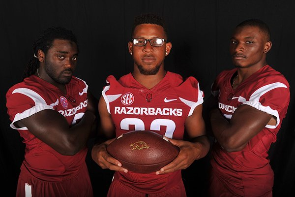 Arkansas running backs (from left to right) Alex Collins, Jonathan Williams and Korliss Marshall pose during the Razorbacks' media day on Sunday, Aug. 10, 2014 in Fayetteville.