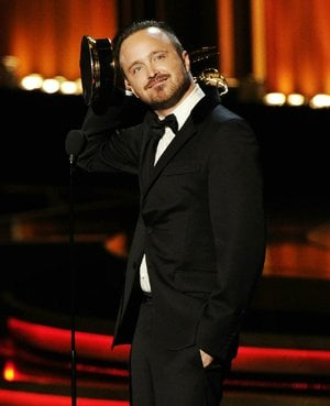 "Aaron Paul accepts the award for outstanding supporting actor in a drama series for his work on ""Breaking Bad"" at the 66th Annual Primetime Emmy Awards at the Nokia Theatre L.A. Live on Monday, Aug. 25, 2014, in Los Angeles. (Photo by Chris Pizzello/Invision/AP)"
