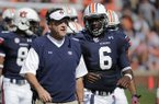 Auburn head coach Gus Malzahn talks with Auburn quarterback Jeremy Johnson (6) in the first half of an NCAA college football game in Auburn, Ala., Saturday, Oct. 12, 2013. (AP Photo/Dave Martin)