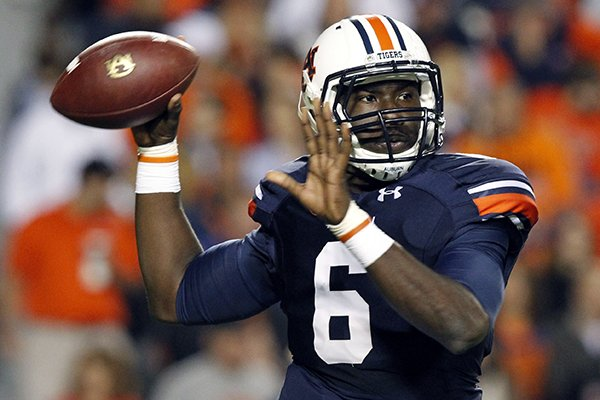 In this Oct. 26, 2013, file photo, Auburn quarterback Jeremy Johnson rolls out to pass during the first half of an NCAA college football game against Florida Atlantic in Auburn, Ala. (AP Photo/Butch Dill, File)