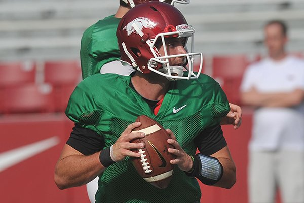 Arkansas quarterback Brandon Allen runs drills during practice on Saturday, Aug. 9, 2014 at Razorback Stadium in Fayetteville.