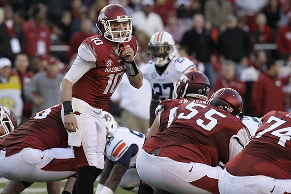 In this Nov. 2, 2013, file photo, Arkansas quarterback Brandon Allen (10) calls a play in the first half of an NCAA college football game against Auburn in Fayetteville. (AP Photo/Danny Johnston, File)