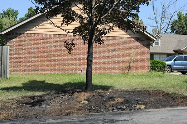 A burned spot marks the place where a truck belonging to University of Arkansas quarterback Brandon Allen was burned early Monday, Aug. 25, 2014, in Fayetteville.