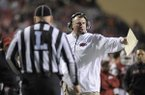 In this Nov. 2, 2013, file photo, Arkansas coach Bret Bielema talks to an official in the second half of an NCAA college football game against Auburn in Fayetteville. (AP Photo/Beth Hall, File)