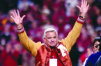 Former Arkansas football player Lance Alworth waves to the crowd while serving as honorary captain prior to the game against Tennessee at Razorback Stadium in Fayetteville on Saturday Nov. 11, 2006.