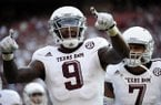 Texas A&M wide receiver Ricky Seals-Jones (9) celebrates with teammate Kenny Hill (7) after scoring a touchdown against South Carolina during the first half of an NCAA college football game on Thursday, Aug. 28, 2014, in Columbia, S.C. (AP Photo/Rainier Ehrhardt)