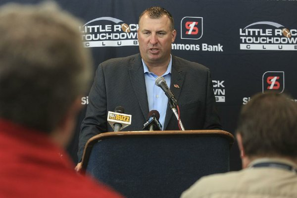 Arkansas Democrat-Gazette/STATON BREIDENTHAL --8/19/14-- Arkansas football coach Bret Bielema answers questions for the media Tuesday before speaking at the opening week of the little Rock Touchdown Club.