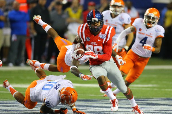 Mississippi wide receiver Cody Core cuts through Boise State defenders for a 76-yard touchdown during the fourth quarter of an NCAA college football game, Thursday, Aug. 28, 2014 in Atlanta. (AP Photo/Atlanta Journal-Constitution, Curtis Compton)