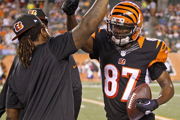 Cincinnati Bengals wide receiver Cobi Hamilton (87) celebrates on the sidelines after scoring a touchdown in the second half of an NFL preseason football game against the Indianapolis Colts, Thursday, Aug. 28, 2014, in Cincinnati. (AP Photo/Frank Victores)