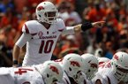 Arkansas quarterback Brandon Allen (10) signals as he walks up to the line during the first half of an NCAA college football game against Auburn on Saturday, Aug. 30, 2014, in Auburn, Ala. (AP Photo/Butch Dill)