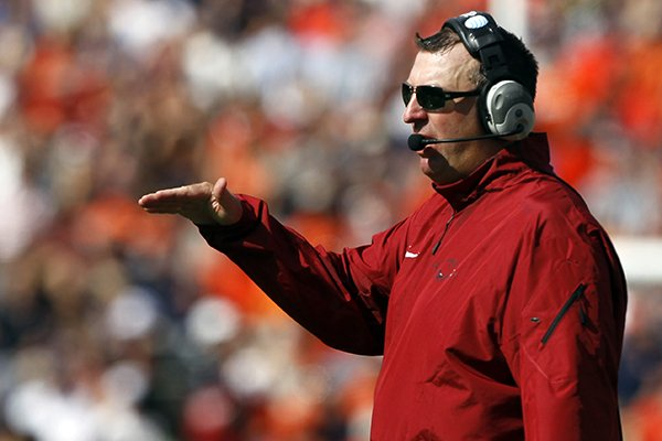 Arkansas head coach Bret Bielema signals to a players during the first half against Auburn of an NCAA college football game on Saturday, Aug. 30, 2014, in Auburn, Ala. (AP Photo/Butch Dill)
