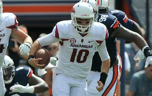 Arkansas quarterback Brandon Allen scrambles during the first quarter of a game on Saturday, Aug. 30, 2014 at Jordan-Hare Stadium in Auburn, Ala.