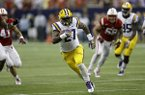 LSU running back Kenny Hilliard (27) rushes for a first down against Wisconsin during the second half of an NCAA college football game Saturday, Aug. 30, 2014, in Houston. LSU won 28-24. (AP Photo/David J. Phillip)