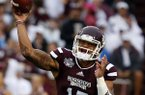 Mississippi State quarterback Dak Prescott (15) throws a pass for a gain in the first quarter of an NCAA college football game at Davis Wade Stadium in Starkville, Miss., Saturday, Aug. 30, 2014. (AP Photo/Rogelio V. Solis)