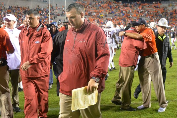 Arkansas coach Bret Bielema heads off the field after the Razorbacks' 45-21 loss to Auburn Saturday, Aug. 30, 2014, at Jordan-Hare Stadium in Auburn.