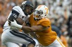 Tennessee defensive end Derek Barnett (9) sacks Utah State quarterback Chuckie Keeton (16) during their NCAA college football game at Neyland Stadium, Sunday, Aug. 31, 2014, in Knoxville, Tenn. . (AP Photo/Knoxville News Sentinel, Amy Smotherman Burgess)