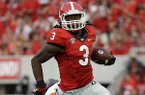 Georgia's Todd Gurley, right, runs past the reach of Clemson's Tony Steward in the first half of an NCAA college football game, Saturday, Aug. 30, 2014, in Athens, Ga. Georgia won 45-21. (AP Photo/David Goldman)