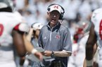 Nicholls State head coach Charlie Stubbs, center, directs his players against Air Force in the second quarter of an NCAA college football game at Air Force Academy, Colo., on Saturday, Aug. 30, 2014. (AP Photo/David Zalubowski)