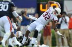 Arkansas running back Jonathan Williams drops a pass during a game against Auburn on Saturday, Aug. 30, 2014 at Jordan-Hare Stadium in Auburn, Ala.