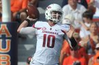 Arkansas quarterback Brandon Allen throws a pass during the Razorbacks' game against Auburn on Saturday, Aug. 30, 2014 at Jordan-Hare Stadium in Auburn, Ala.