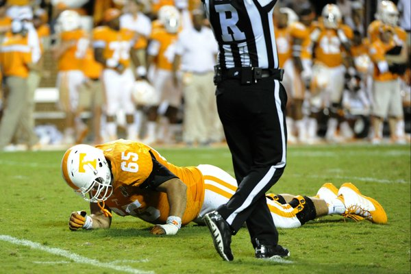 In this Aug. 31, 2014, photo, Tennessee left tackle Jacob Gilliam is injued on a play during an NCAA college football game against Utah State in Knoxville, Tenn. Gilliam is out for the season with a torn anterior cruciate ligament according to coach Butch Jones. (AP Photo, Michael Patrick/Knoxville News Sentinel)