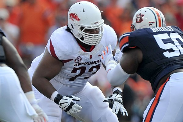 Arkansas offensive lineman Sebastian Tretola sets up to block Auburn defender Ben Bradley during a game Saturday, Aug. 30, 2014 at Jordan-Hare Stadium in Auburn, Ala.