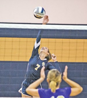 STAFF PHOTO ANTHONY REYES • @NWATONYR Reagan Robinson of Shiloh Christian goes for a kill against Berryville on Tuesday at Shiloh Champions Gym in Springdale. The Lady Saints won 3-0.