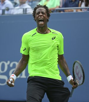 Gael Monfils, of France, reacts after a shot against Grigor Dimitrov, of Bulgaria, during the fourth round of the 2014 U.S. Open tennis tournament, Tuesday, Sept. 2, 2014, in New York.