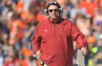 Arkansas coach Bret Bielema walks the sideline during a game Saturday, Aug. 30, 2014 at Jordan-Hare Stadium in Auburn, Ala.