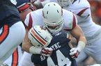 Arkansas linebacker Brooks Ellis tackles Auburn running back Cameron Artis-Payne during a game Saturday, Aug. 30, 2014 at Jordan-Hare Stadium in Auburn, Ala.