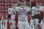 Arkansas offensive guard Denver Kirkland goes through practice on Wednesday, Aug. 13, 2014 at Razorback Stadium in Fayetteville.