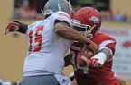 Arkansas defensive tackle Taiwan Johnson sacks Nicholls State quarterback Kalen Henderson (15) in the first quarter during their game at Reynolds Razorback Stadium in Fayetteville on Saturday, Sept. 6, 2014